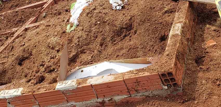 corpo encontrado fora do caixão